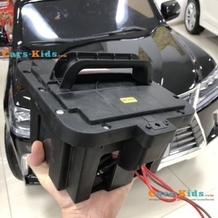 Электромобиль LEXUS LX 570 4WD черный (легко съемный аккумулятор, 2х местный, колеса резина, сиденье кожа, пульт, музыка)